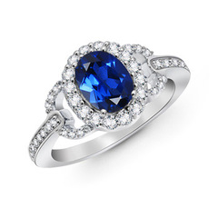 Vintage Inspired Oval Lab Created Sapphire Halo Ring with Diamond Accents