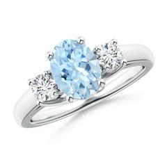 Oval Aquamarine and Round Diamond Three Stone Ring